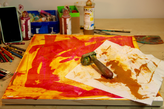 Fling water randomly on the surface and scrape again or blot with paper towels to remove some paint. Continue until the surface is covered with paint, then stop, set aside and do another! This whole process should take about 10 minutes and be done in sync with the music. I recommend laying out several canvases or boards to create several underpaintings for a series of paintings.
